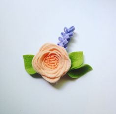 Peach and Lavender Felt Flower Headband or Hair Clip by BobanaBoutique on Etsy https://www.etsy.com/listing/465476849/peach-and-lavender-felt-flower-headband