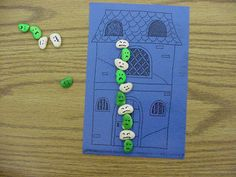 Spray paint lima beans and draw on faces to make ghosts, jack-o-lanterns or goblins to use for patterning, counting or problem solving. The story board mats are from Box It or Bag It Math.