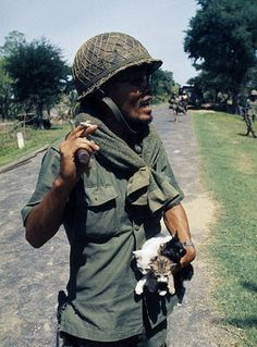 1974, Cambodia. Since the Lon Nol coup in March 1970, two groups are fighting for control - the Khmer National Armed Forces (FANK) see here, supported by the USA, and the Army of the Republic of Vietnam (ARVN), pitted against the Cambodian People's National Liberation Armed Forces, (composed of Maoist nationalists and Khmer Rouge communists) supported by North Vietnam and the Vietcong. Government soldier with kittens.