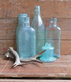 Aqua apothecary bottles- I have a small collection that i love.