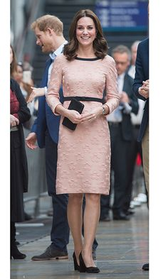 Pregnant Duchess Kate stepped out in an Orla Kiely dress featuring a daisy motif and black bow belt.