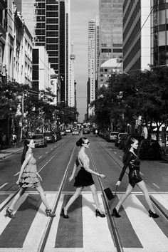 Chic fashionista ladies getting their Beatles on! Fun photo! I'd love to take one in this pose with my best gal pals too.