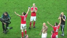 Wales players sing anthem with the fans