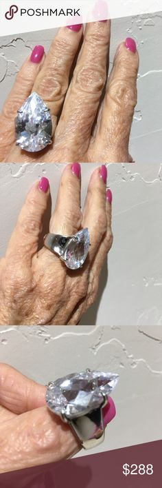 FLASH🚨SALE🚨 I am selling a GORGEOUS HUGE AUTHENTIC WHITE TOPAZ ring in a heavy four prong sterling silver setting... this designer lis featured in ELLE Magazine.. classic ring with a Uber WOW  factor...The perfect ring for your girlfriends to drool over you will absolutely love this ring size 4.75 Jewelry Rings