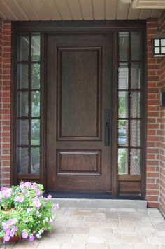 Example of custom wood door with glass surround interior barn this stained woodgrain fiberglass door system gives a classic traditional feel to this home planetlyrics Images