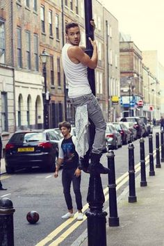 When he climbed onto was is now officially the luckiest pole on the face of this planet. | 30 Times Liam Payne Was The Most Perfect Member Of One Direction In 2013