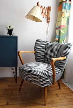Love the lamp and chair, with the colourful drapes