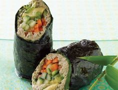 Sunny Raw Nori Rolls:     2 cups hulled sunflower seeds     8 green onions, green parts only     ¼ cup cilantro leaves     ¼ cup lemon juice     2 Tbs. Bragg Liquid Aminos     4 cloves garlic     6 small collard green leaves     8 sheets raw (untoasted) nori     2 carrots, peeled and cut into thin strips     1 cucumber, peeled, seeded, and cut into thin strips     1 avocado, halved and thinly sliced     1 8-oz. container daikon sprouts or sunflower sprouts