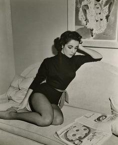 Elizabeth Taylor, reading.
