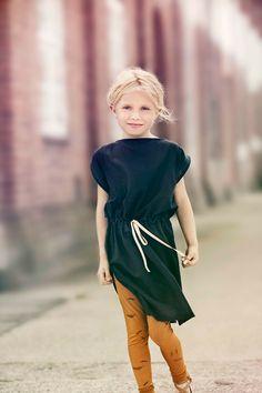 Love the simplicity of her black dress. #kids #designer #fashion