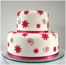with red and white cupcakes around it?