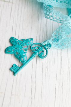 Turquoise Skeleton Key with butterfly $20.00