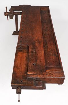 View this item and discover similar for sale at - A monumental antique craftsman's workbench from the Italian Alps (Limone), used in the making of skis. Solid wood, complete with handcrafted wooden and