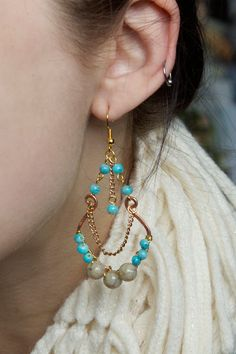 Pretty hues of turquoise blue, beige, antique copper and gleaming gold mix here to create a totally tropical-bohemian look! This chic fiesta of hippie goodness just reminded me of something you'd wear on the sandy beaches of Tulum (or really any other oceanside getaway!)….. These chandelier-style earrings are surprisingly light, and surprisingly easy to make. … Continue Reading