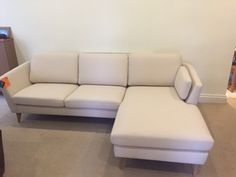 Compact right hand facing sofa chaise measuring 250 cm x 154 cm.  Oak wood feet.  Covered in Warwick Fabrics – Jackson biscuit