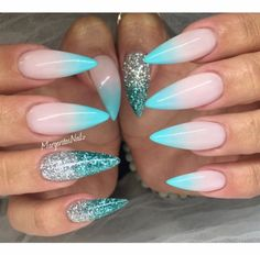 Winter themed blue white pink and glitter stiletto nails