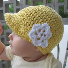 Photobucket free crochet newsboy hat pattern- for a boy just add a strap n buttons instead of flower.