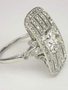Edwardian platinum and diamond dinner ring.  wow. #SilverJewelry