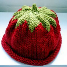 Baby Hat.....the pattern says tomato hat, but you could easily make this a strawberry hat by sewing some beads on it for the seeds, or by knitting them in as you go.