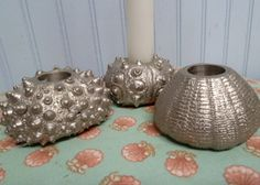 $35 via http://www.smallholdingsfarm.com/shop/set-of-3-seaside-candle-holders/ - Set of 3 Seaside Candle holders.  Silver tone and heavy weight…great for indoors or out.  Each measure approximately 2 1/2″ to 3″ across.  Adds an elegant touch to any table decor.  Free Shipping
