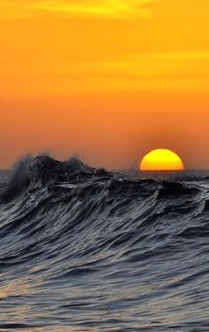 Sunset and ocean waves.