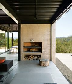 Photo by Dwight Eschliman  Marmol Radziner, which does architectural, landscape design, and construction in LA (not to mention prefab structures), designed this fireplace with shelf and wood storage.