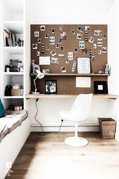 Cork board, built ins, white mid century modern chair, Scandinavian style home office