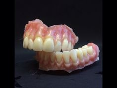 Contoured and gum stained complete dentures, ready to trim and polish