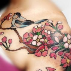 bird on a floral branch tattoo