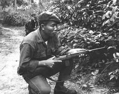 """""""United States Marines and Vietnamese Popular Forces soldiers set up an ambush near a small village along the Song Nong River in the Hue-Phu Bai district of Vietnam. This is a newly formed Joint Action Company, composed of Marines and Vietnamese."""" (1965)"""