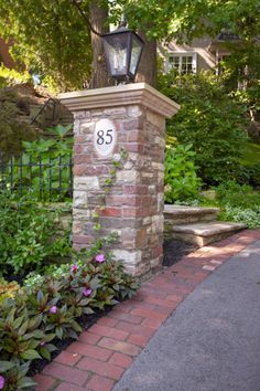 Try brick edging on your driveway to make it more appealing, and incorporate old fashioned brick columns. - This is for brick column & light on single oil co. metal post on left of entry before gates (with other post removed to widen entry, & put mailbox Brick Driveway, Asphalt Driveway, Driveway Design, Driveway Gate, Driveway Posts, Driveway Border, Brick Pavers, Front Gates, Entry Gates