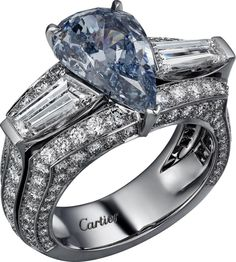 "CARTIER. ""Bleu Azur"" Ring - platinum, one 3.45-carat fancy vivid blue SI2 Type IIb pear-shaped diamond, two tapers diamonds totaling 1.22 carats, brilliant-cut diamonds. #Cartier #ÉtourdissantCartier #2015 #HauteJoaillerie #HighJewellery #FineJewelry #FancyVivid #BlueDiamond #Diamond"