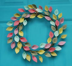 This beautiful wreath is perfect for Spring and Summer! 100% wool and wool-blend felt leaves in shades of mint, rose, lavender, sage, and chartreuse