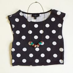 TopShop Petite Polka Dot Crop Top Sold out online! The name says it all. Black with large white polka dots. Sleeveless stretch tank crop top. 93% Cotton, 3% Elastic. Little black blemish on one of the dots as pictured. Price reflects. Topshop Tops Crop Tops