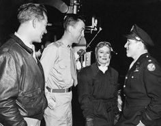 """Jimmy Stewart visiting Spencer Tracy, Irene Dunne and Ward Bond on the set of """"A Guy Named Joe"""" (1943)"""