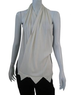 Designer: Issei Fujita    Item: Scarf    Composition: 100% Silk    Made in Italy    Description:    Scarf with peaks at the bottom in silk eco-friendly.      > Need Help?    Price $ 322.00 $159.00    Discount: -51%
