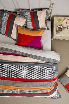I'm in love with these colors. Yellow, burnt orange, gray and cream hello bedroom colors.