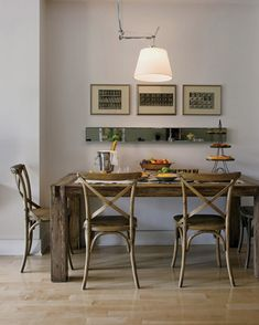 I like the long skinny mirror on the back wall in this dining room