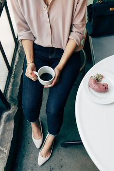skinny jeans, pointy shoes, and a loose, tucked silk blouse. loving the dusty rose colour of the blouse, and the fact that it doesn't have pockets