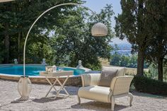 Canopo servant, Canopo arc floor lamp and Canopo armchair for a luxury outdoor