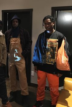 ASAP Rocky wearing Alpha Industries MA-1 Slim-Fit Jacket, Jordan Air Jordan 1 Retro High Bred