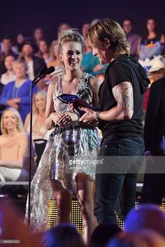 Carrie Underwood (L) and Keith Urban (R) accept an award onstage during the 2017 CMT Music awards at the Music City Center on June 7, 2017 in Nashville, Tennessee.