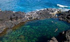 Swim Queen's Bath on the island of Kauaʻi, Hawaii
