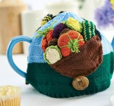 Teacosy allotment, found on : http://www.letsknit.co.uk/images/content/pattern-download/pdf/Allotment.pdf  Login required.
