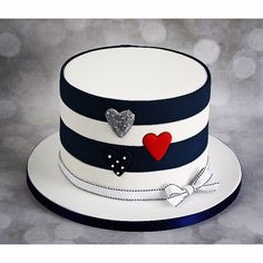 Navy striped birthday cake with inlaid hearts - pontycarlocakes