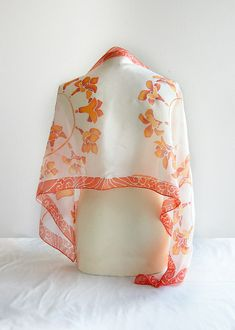 Silk scarf FRESIA is a handpainted silk scarves decorated with orange flowers on a white background. This silk scarf was designed as my impression over Japanese kimono silk painting art. The color composition is simple and refreshing. You can see orange flowers of Freesia and a orange -