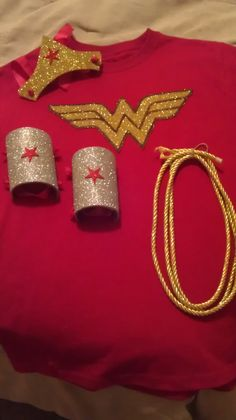 My homemade/DIY Wonder Woman costume. The cuffs, tiara, and W are made from adhesive Glitter Foam Sheets, and the lasso is two yards of Home Decor Trim Cord.