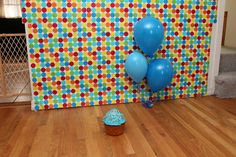 Use wrapping paper for the background- cheap and easy.  DIY Cake Smash Photo Session