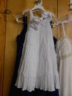 The flower girl's dress ready for her.
