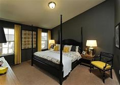 i love the bold statement that the dark gray wall makes in this master bedroom. a bit masculine but it works!